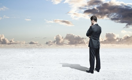 businessman thinking and blue sky photo