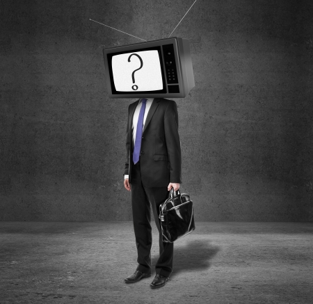 businessman with tv head on concrete room photo