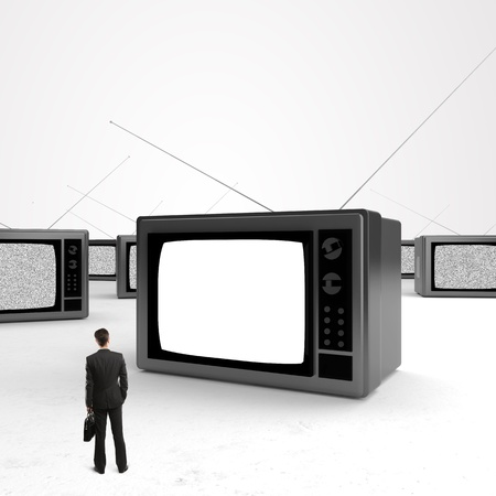 businessman with briefcase looking at tv photo