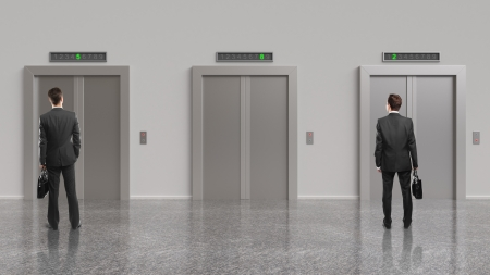 people in elevator: two businessman and elevator with closed doors