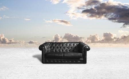 black sofa on nature background photo