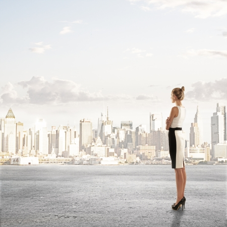 businesswoman standing and looking on city photo