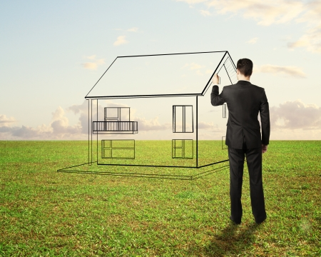 businessman drawing house on field background photo