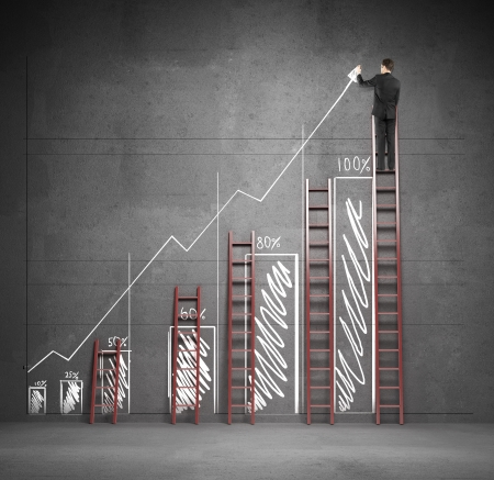 businnessman drawing chart with three ladders Stock Photo