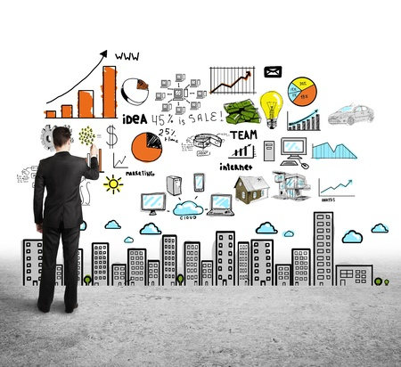 whiteboard: man drawing color concept city on white background Stock Photo