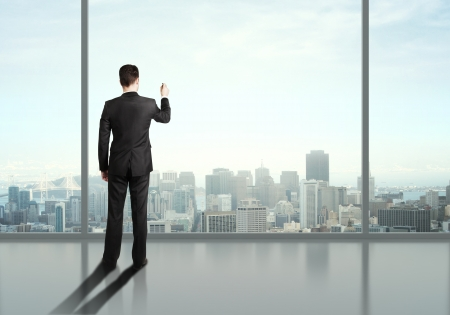 office windows: man drawing on the office window