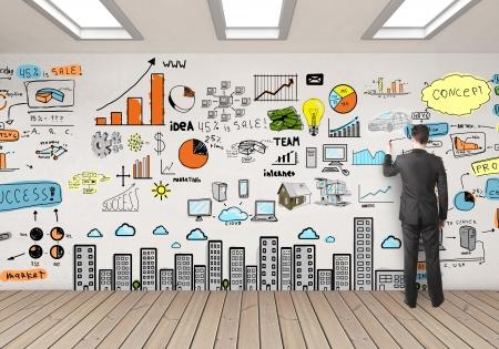 communicatie: zakenman tekening kleur bedrijfsstrategie op de muur Stockfoto