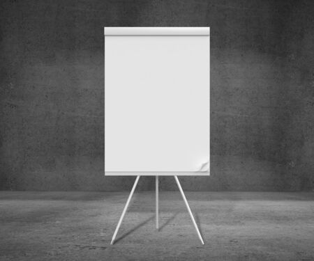 blank flipchart on tripod and concrete room