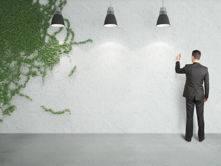 ivy wall: businessman drawing on wall and ivy