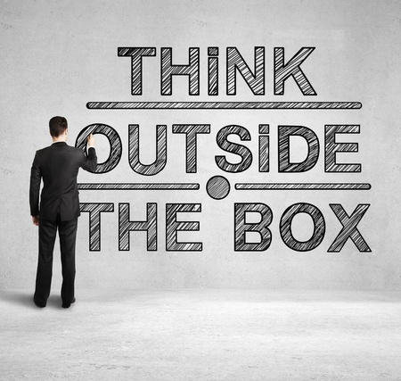 outside the box: man drawing think outside the box