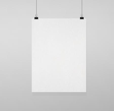 blank poster clips on white wall Stock Photo