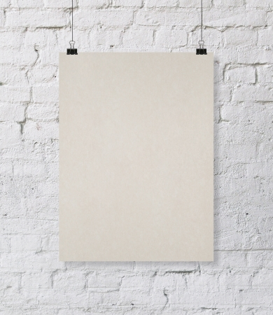 white brick wall: placard hanging on a rope and brick wall Stock Photo
