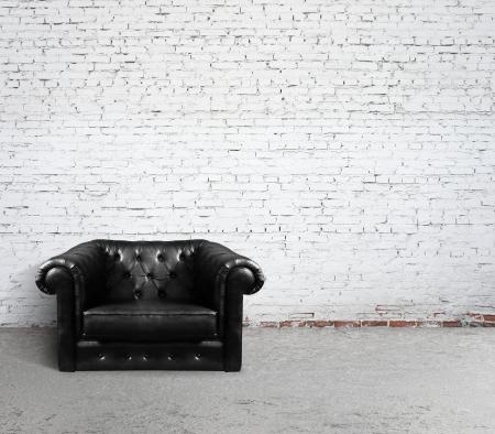 leather sofa in brick room photo