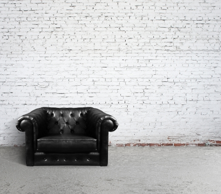 cracked concrete frame: leather sofa in brick room