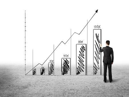 businnesman drawing graph on white background Stock Photo - 18761038