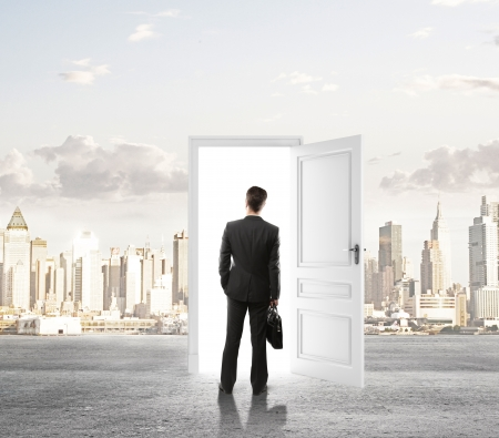 businessman looking at door in city photo