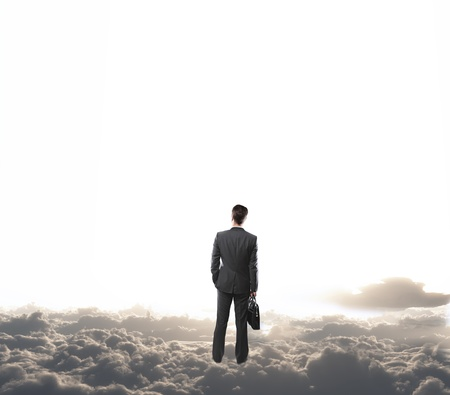 businessman with briefcase standing on a cloud Stock Photo - 18768044