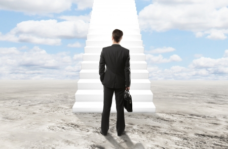 floor standing: businessman looking at stairs to heaven