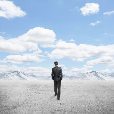 people looking up: businessman walking and blue sky