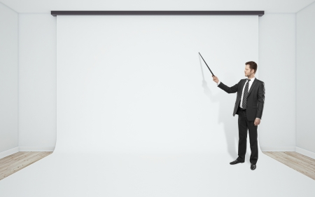 businessman pointer to white background in room photo