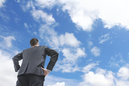 businessman looking on blue sky photo