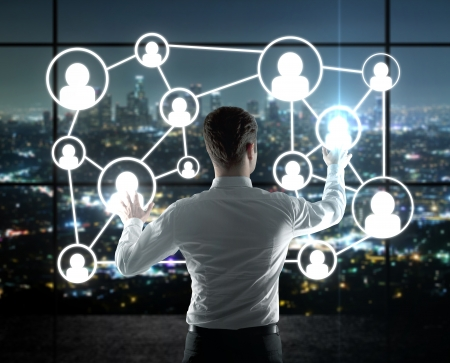 virtual community: businessman pushing interface with social icons
