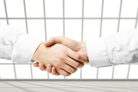 hand shake in loft office Stock Photo - 18920621