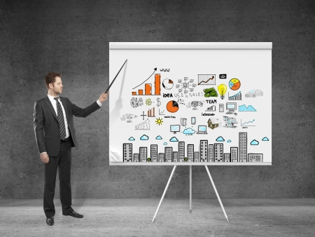 internet business: businessman  pointing at business plan on flip chart Stock Photo