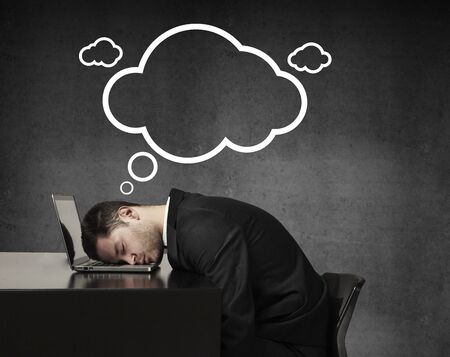 businessman sleeping and dreaming with drawing cloud photo