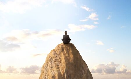 mountin: businessman sitting on peak mountin