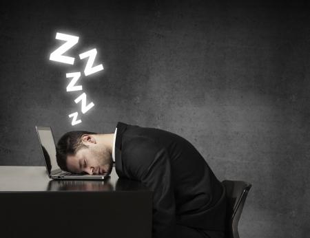 young man sleeping on laptop Stock Photo
