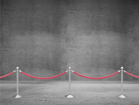 barrier rope: stanchions barrier on concrete room Stock Photo