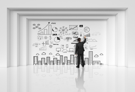 businessman dgawing at drawing business strategy on wall Stock Photo - 19063798