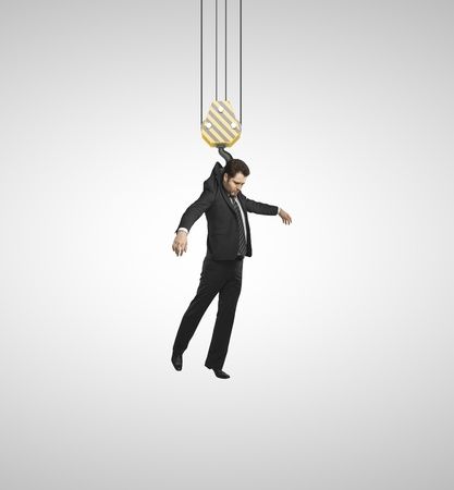 hangs: businessman hangs hook on gray background Stock Photo