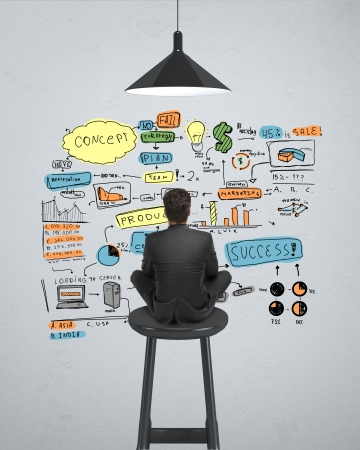 businessman sitting on stool and looking at  business concept