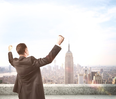 success business: happiness businessman on roof skyscraper