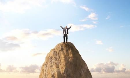 mountin: happiness businessman standing on peak mountin Stock Photo