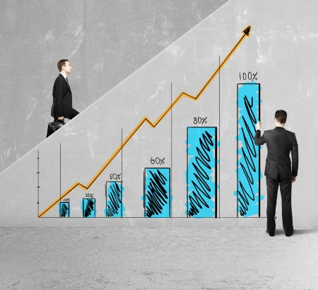 businessman drawing business chart on ladder photo