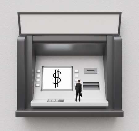 tiny businessman looking at atm display photo