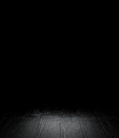 darkness: gray floor passing into darkness Stock Photo