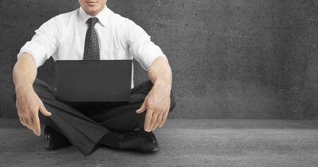 meditation room: businessman sitting on floor in lotus position Stock Photo