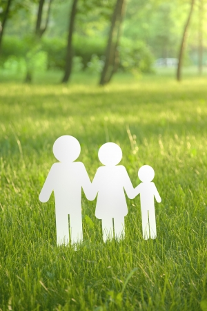 tree linked: paper family on green grass Stock Photo