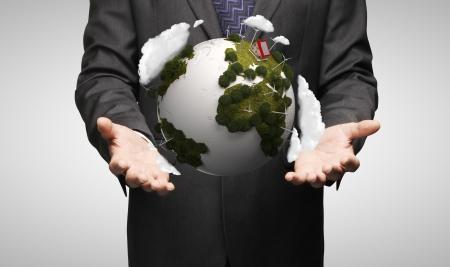 singn: men holding earth on gray background