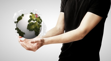 singn: hands holding earth on gray background