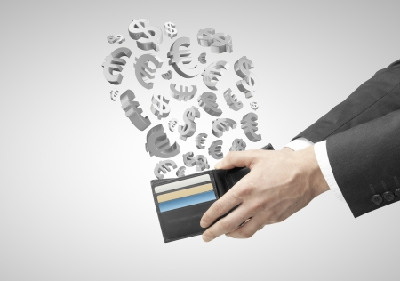 hands holding purse with flying dollars and euros Stock Photo - 19434495