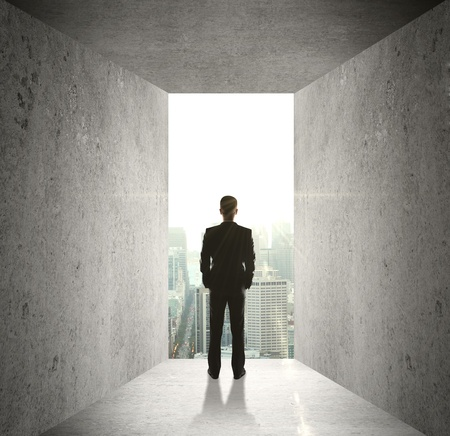 businessman looking at opened concrete wall photo