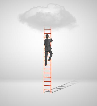 businessman climbing on ladder  to cloud photo