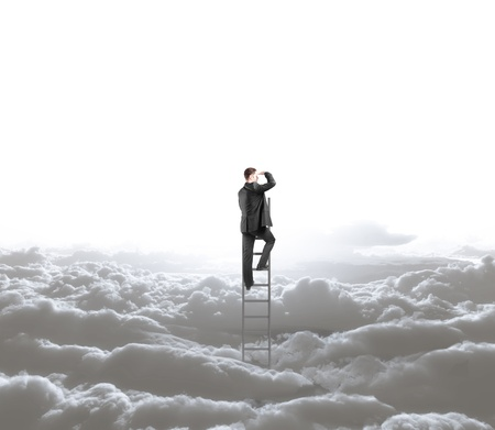 climbing ladder: man climbing on ladder and skyscape with clouds