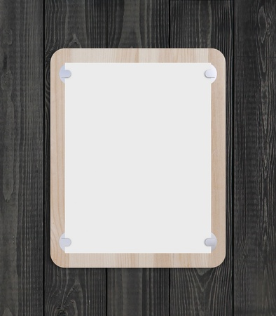 wooden clipboard on black wood background photo