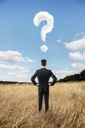 man looking in landscape and question mark photo